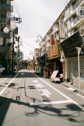 photo of empty street between buildings